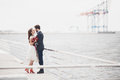Married wedding couple standing on a wharf over the sea Royalty Free Stock Photo