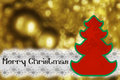Marry christmas silhouette of a tree on a gold background Stock Photography