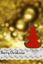 Marry christmas silhouette of a tree on a gold background Royalty Free Stock Image