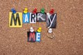 Marry me pinned to a cork board background Stock Photo