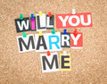 Marry me will you pinned on cork bulletin board Royalty Free Stock Image