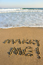 Marry me word drawn on the beach Royalty Free Stock Photo