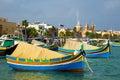 Marsaxlokk market with traditional colorful fishing boats malta at Royalty Free Stock Photo