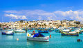 Marsaxlokk village with traditional colorful fishing boats luzzu in malta Royalty Free Stock Photo