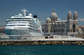 Marseille cathedral and a cruise ship large docked under byzantine Royalty Free Stock Photo