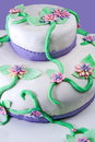 Marshmallow multilayer cake decorated with isolated on violet background Royalty Free Stock Image
