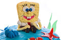 Marshmallow spongebob cake closeup close up of a multilayer decorated with with squarepants character on top isolated on white Royalty Free Stock Photos