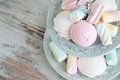 Marshmallow vanilla and rosewater marshmallows on a antique plate on a wooden background selective focus Royalty Free Stock Photo