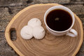 Marshmallows and mug coffee on the saw cut of a tree on wooden Royalty Free Stock Photo