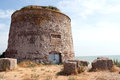 Martello tower old fortification on beach near eastbourne one of many built around the english coastline to protect its shores Royalty Free Stock Photography