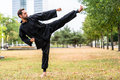 Martial artist practicing Qigong in office break Royalty Free Stock Photo