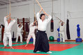 Martial arts aikido training session a black belt master shows a sword strike example during a Stock Image
