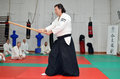 Martial arts aikido training session a black belt master shows a sword strike example during a Royalty Free Stock Image