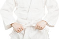 Martial arts and all things related art fighter holding his belt on a white background Royalty Free Stock Image