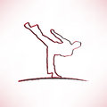 Martial arts icon of a silhouette doing standing side kick Royalty Free Stock Photography