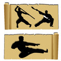 Martial arts karate and kunf fu silhouettes on abstract papyrus paper Royalty Free Stock Images
