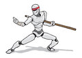 Martial arts robot with staff in a pose Royalty Free Stock Images