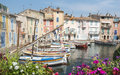 Martigues provence france bouches du rhone alpes cote d azur the old harbor with boats and flowers Royalty Free Stock Photography