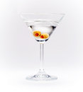 Martini anyone closeup of cocktail with olives on white grey background Royalty Free Stock Photography