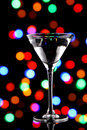 Martini cocktail with christmas lights Royalty Free Stock Photo