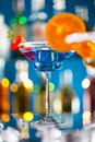 Martini drink served on bar counter with blur bottles background Royalty Free Stock Images