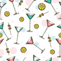 Martini glass with colorful drinks in engraved style. Seamless pattern of cocktails on white background.