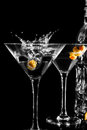 Martini glass with olive on black background Stock Photo