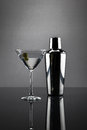 Martini glass and shaker on grey background Royalty Free Stock Photo