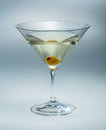 Martini with olive isolated vermouth cocktail Royalty Free Stock Images