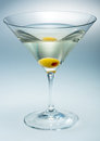 Martini with olive isolated vermouth on grey Royalty Free Stock Photo