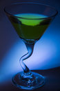 Martini with olive martinis olives blue backlight Royalty Free Stock Photography
