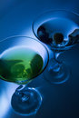 Martini with olive martinis olives blue backlight Stock Photos