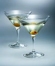 Martini with olive vermouth cocktail isolated two glasses Royalty Free Stock Photography