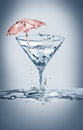 Martini party a glass of made of water with a red umbrella inside Stock Images