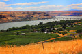 Maryhill riverside community view of a groomed peaceful orchard neighborhood in summer with buildings trees bridge over river and Stock Photo