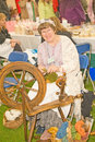 Marymas Fair: spinning and combing wool. Royalty Free Stock Photography