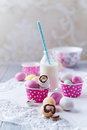Marzipan easter eggs and a milk bottle with straw colorful chocolate of paper Royalty Free Stock Photography
