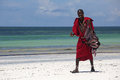 Masai man selling traditional products to the tourists near hotel resorts far away from s natural enviroment Royalty Free Stock Photo
