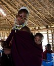 Masai teacher with baby. Stock Image