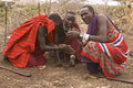 Masai warriors lighting fire with wood and paper Stock Photography