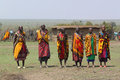 Masai women song the welcome danced only by dressed with colorful clothes necklace and bracelet Stock Photos