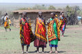 Masai women song the welcome danced only by dressed with colorful clothes necklace and bracelet Royalty Free Stock Photos