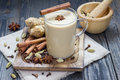 Masala chai with spices. Cinnamon stick, cardamom, ginger, clove, star anise, black pepper. Royalty Free Stock Photo