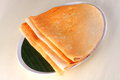 Masala dosa ghee roast is avery popular recipe in india a thin lentil and rice crepe filled with cooked potato onion Stock Image