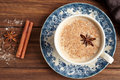 Masala tea chai latte traditional hot Indian sweet milk with spices, cinnamon stick, herbs blend organic infusion Royalty Free Stock Photo
