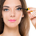 Mascara applying close up portrait of a young woman Royalty Free Stock Photos