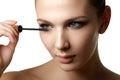 Mascara applying closeup, long lashes. Mascara brush. Eyelashes Royalty Free Stock Photo