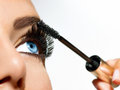 Mascara applying long lashes closeup Royalty Free Stock Image