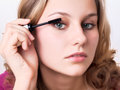 Mascara woman face makeup applying eyes make up Royalty Free Stock Image
