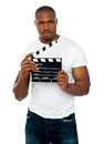 Masculine african male holding clapperboard Royalty Free Stock Photo